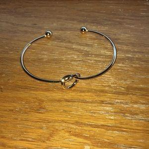 Gold tone knot bracelet.